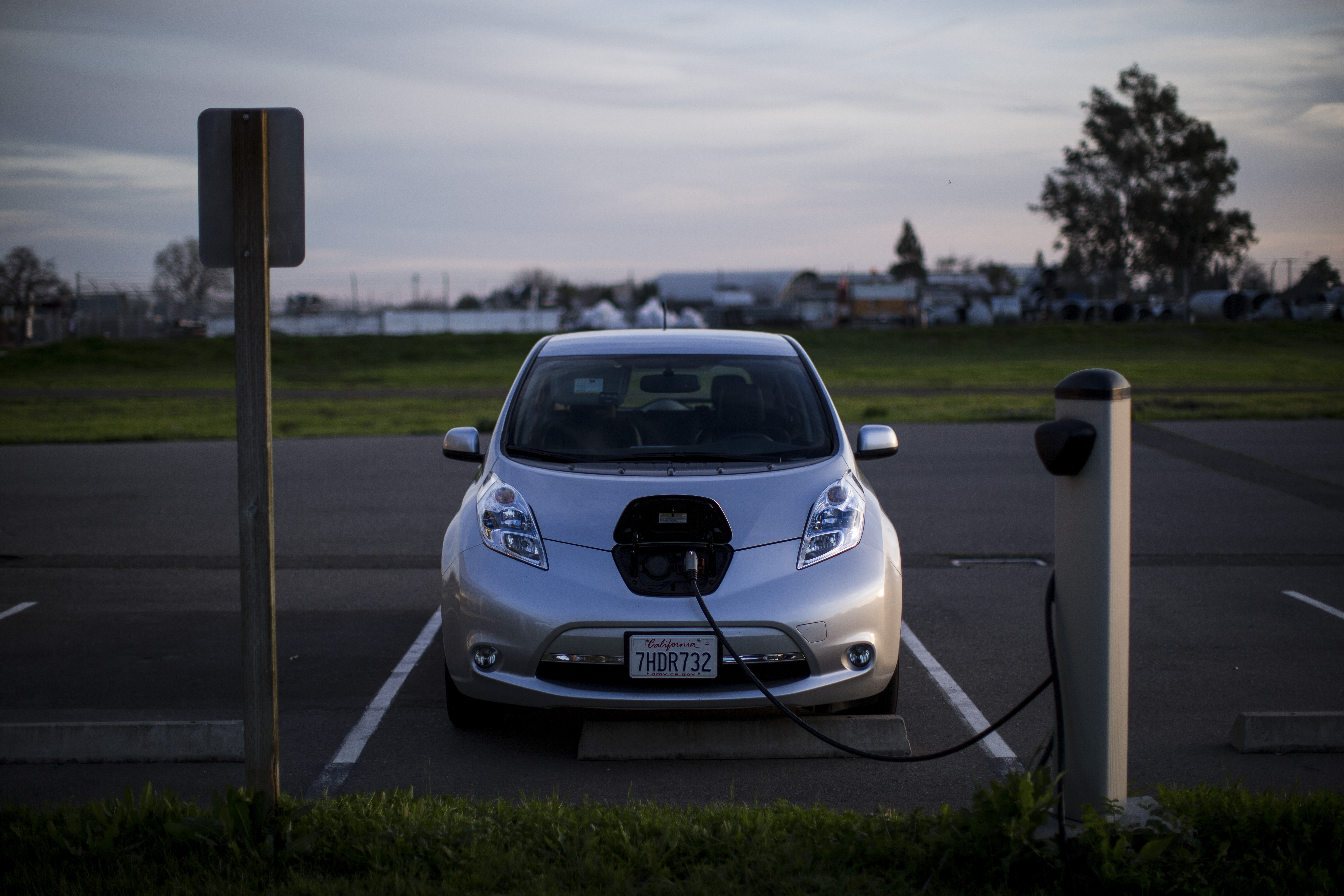 An electric car charges at a station in a parking lot in Sacramento, Calif.
